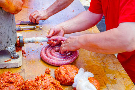 Fill up pig intestines to make sausage with machine for handmade sausages.