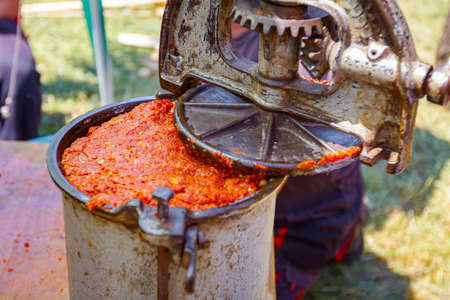 Manually machine is full with minced meat, process for making sausages at outdoor kitchen. Stok Fotoğraf