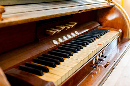 View on obsolete ancient wooden organ keyboard in Roman Catholic Church in Ivanovo.