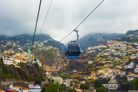 The cable car over the houses on the hillside. 스톡 콘텐츠