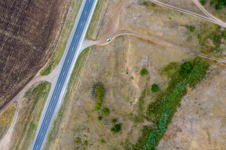 Top view of a rural landscape with a highway. Aerial photography. Shooting from a drone.