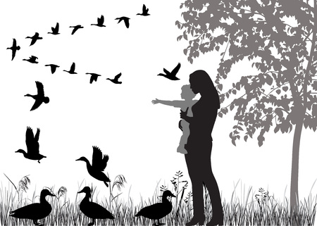Woman with child in her arms looking at the flying ducks, in silhouettes