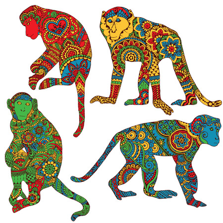 Four brightly colored monkey decorated with Indian designs