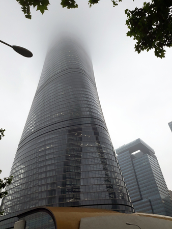 Shanghai Tower disappearing in the fog. May 2018. Redakční