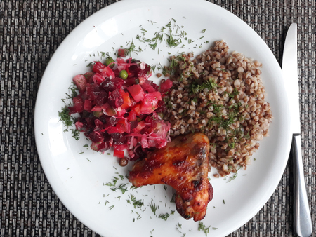 Homemade food. Chicken, buckwheat and vegetable salad - vinaigrette.