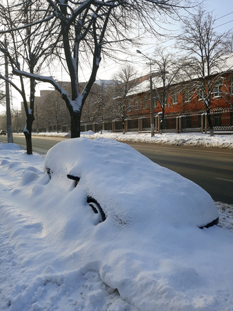 Winter in Europe. Snow covered car. Banco de Imagens