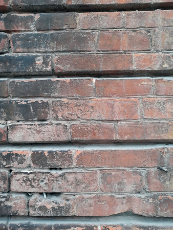 Texture of the old brick wall. The bricks of one of Yekaterinoslav ancient facts (until 1919) are hand-molded.