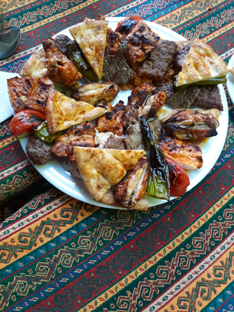 Turkish food from the grill. Beef plate with flat bread