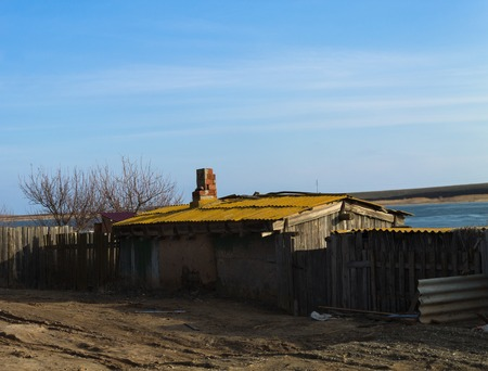 travel features: house on the street near the lake.Astrakhan. Asia. Stock Photo