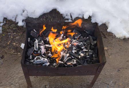 brazier: Coal burning in the brazier.