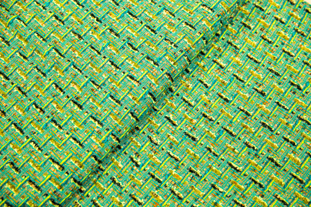 Green fabric for coat dress, With black and yellow lines, background fabric, top view Фото со стока