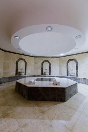 Hammam Turkish bath, steam room with hot stones, background, taps