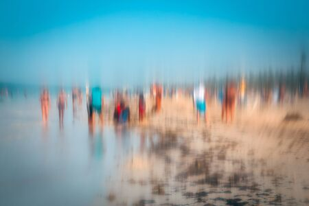 Abstract photo effect of people walking on the beach in the colorful impressionist style. Soft focus. A blurring technique creates a unique impressionist style. Pastel colours. Bavaro beach, Punta Cana, Dominican Republic.
