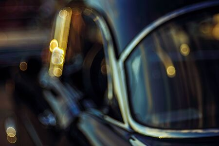 Colorful abstract background retro car. Boke background with copy space. Close-up view vintage American auto details with bubble bokeh effect. Evening. Фото со стока