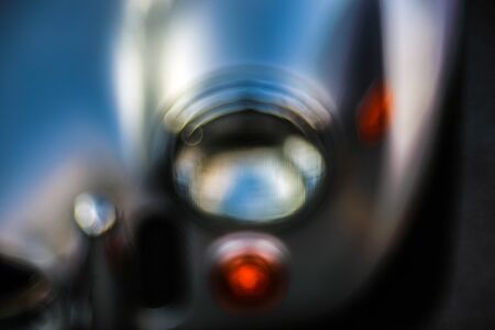 Retro headlight lamp vintage classic car. Soft focus, boke background with copy space. Close-up view part of a vintage old car with bubble bokeh effect. Archivio Fotografico