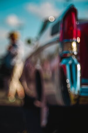 Colorful abstract background retro car. Boke background with copy space. Close-up view vintage American auto details with bubble bokeh effect. Фото со стока