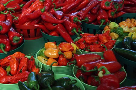 Biologic, natural cultivated hot pepper on a market counter. Vegetables from the farmers market. Ecologic products. Natural background. Stock Photo