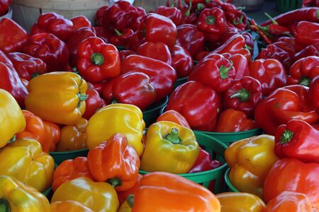 Biologic, natural cultivated sweet pepper on a market counter. Vegetables from the farmers market. Ecologic products. Natural background.