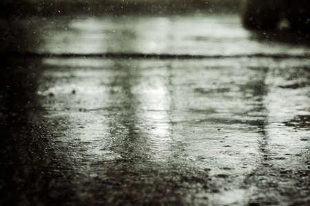 Asphalt in heavy rain on a cloudy day.