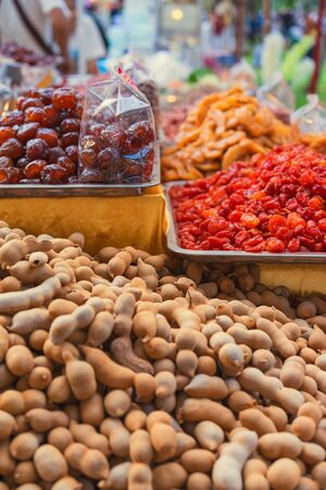 Tamarind and dried fruits on asian market, close up