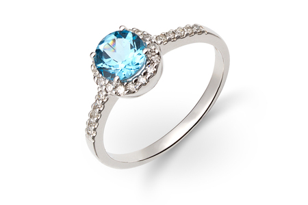 Gold ring with blue and white gem Stock Photo