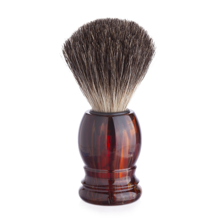 Classic shaving brush with raccoon fur isolated on white