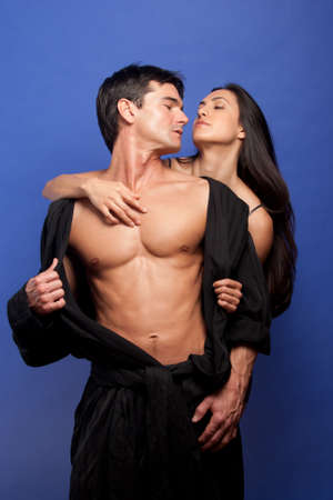 The hot couple pose together for the photo.