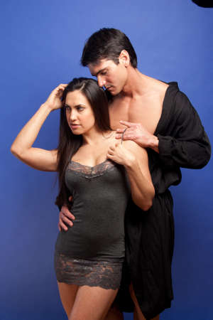 The hot couple pose together for the photo. Archivio Fotografico