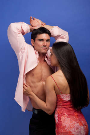 The couple pose together for the photo.