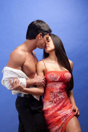 The couple share an embrace together. Stock Photo