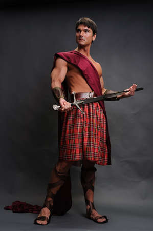 The handsome highlander poses for the photo. Stock Photo