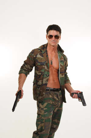 The handsome army man poses for the photo.