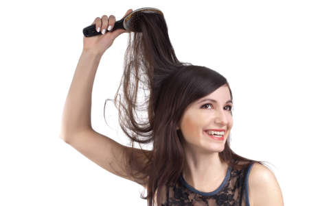 eastern european ethnicity: The beautiful girl smiling combs to itself hair
