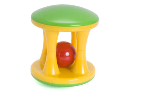 play date: plastic multi-coloured rattle for newborns isolated aganist white background Stock Photo