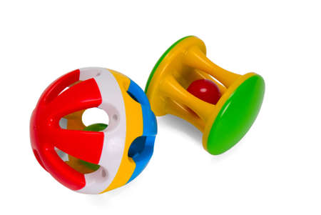 plastic multi-coloured rattle for newborns isolated aganist white background photo