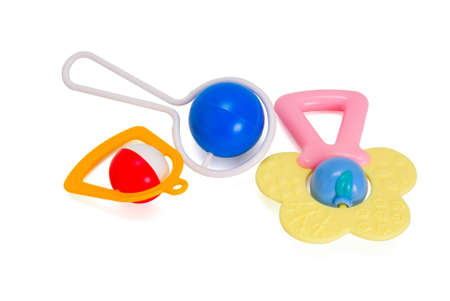 Three plastic multi-coloured rattle for newborns isolated aganist white background photo