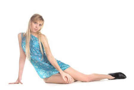eastern european ethnicity: Beautiful girl in a blue dress sits on a floor