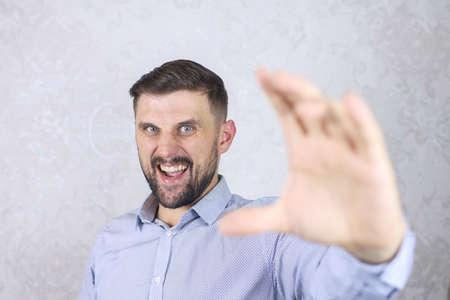 a man with a beard in a shirt Stok Fotoğraf