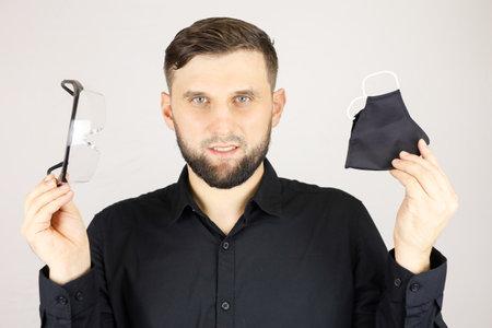 a man holds a black medical mask Stock fotó