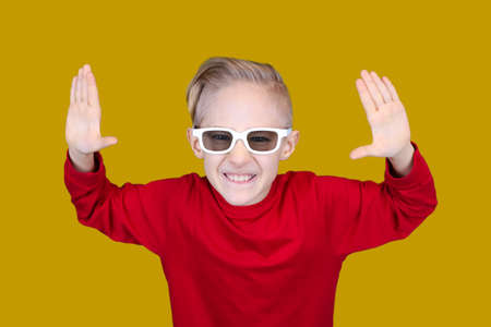a child in children's 3D glasses covered his eyes with his hand Stock fotó