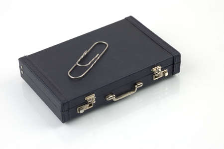 detective agency: black, suitcase, clip, shine, cold, secure, chrome, key, shut, private, light, seems, handle, shiny, luggage, case, texture, silver, detective, reflect, metal, lock, packing, bright, suit, closed, tight, secretary, mark, business, equipment, agency, paper Stock Photo