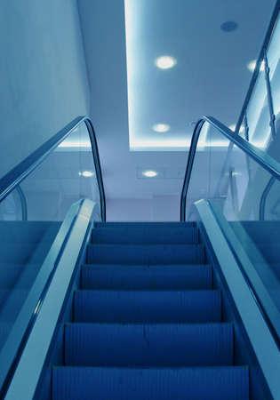 Business center escalator steps in a blue light photo