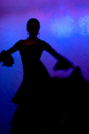 fan dance: Flamenco dancer silhoete over blue background