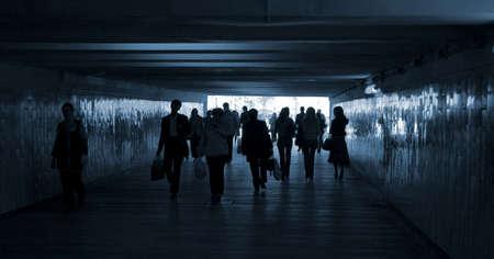 people walk through the tunnel photo
