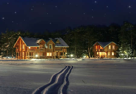 snowing: stars sparkle photo collage with cottage under snow and ski way across the snow field