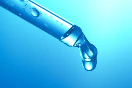 Medicine dropper close up in blue light photo