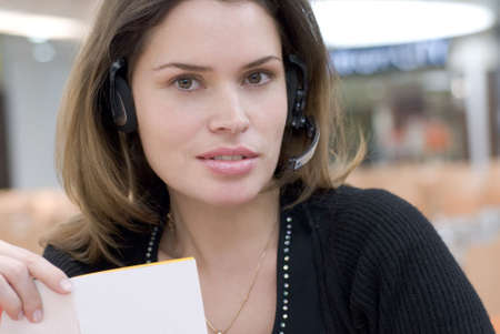 Secretary in call center answering with handsfree photo