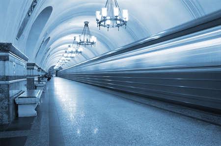 Ghost train running through empty railway station