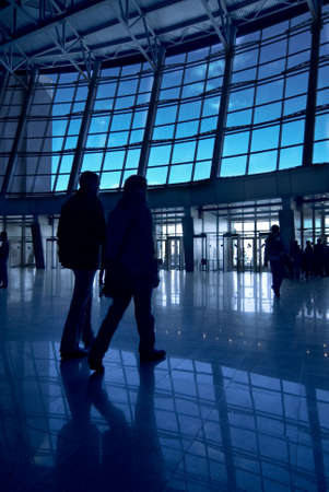 People silhouettes at airport building Stock Photo
