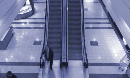 People on escalator in shopping center photo